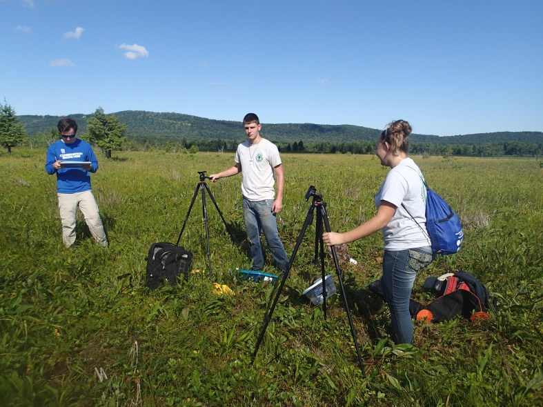 The YCC crew performs monitoring for bats on a beautiful summer day in Cannan Valley. (Photo caption; Holly Black.)