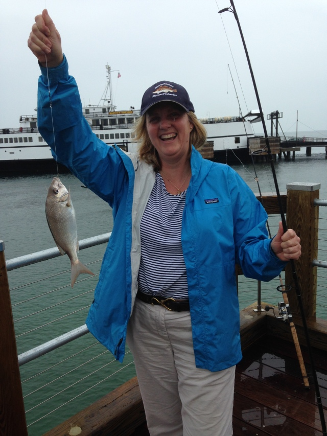 A happy angler showing off her catch from the pier on Martha's Vineyard. Photo credit: Ross K. Kessler, Massachusetts Division of Marine Fisheries