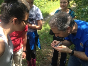 Dr. Randy Dettmers shows bird age identification techniques to high school girls from the Flying Cloud Institute at Conte Refuge.