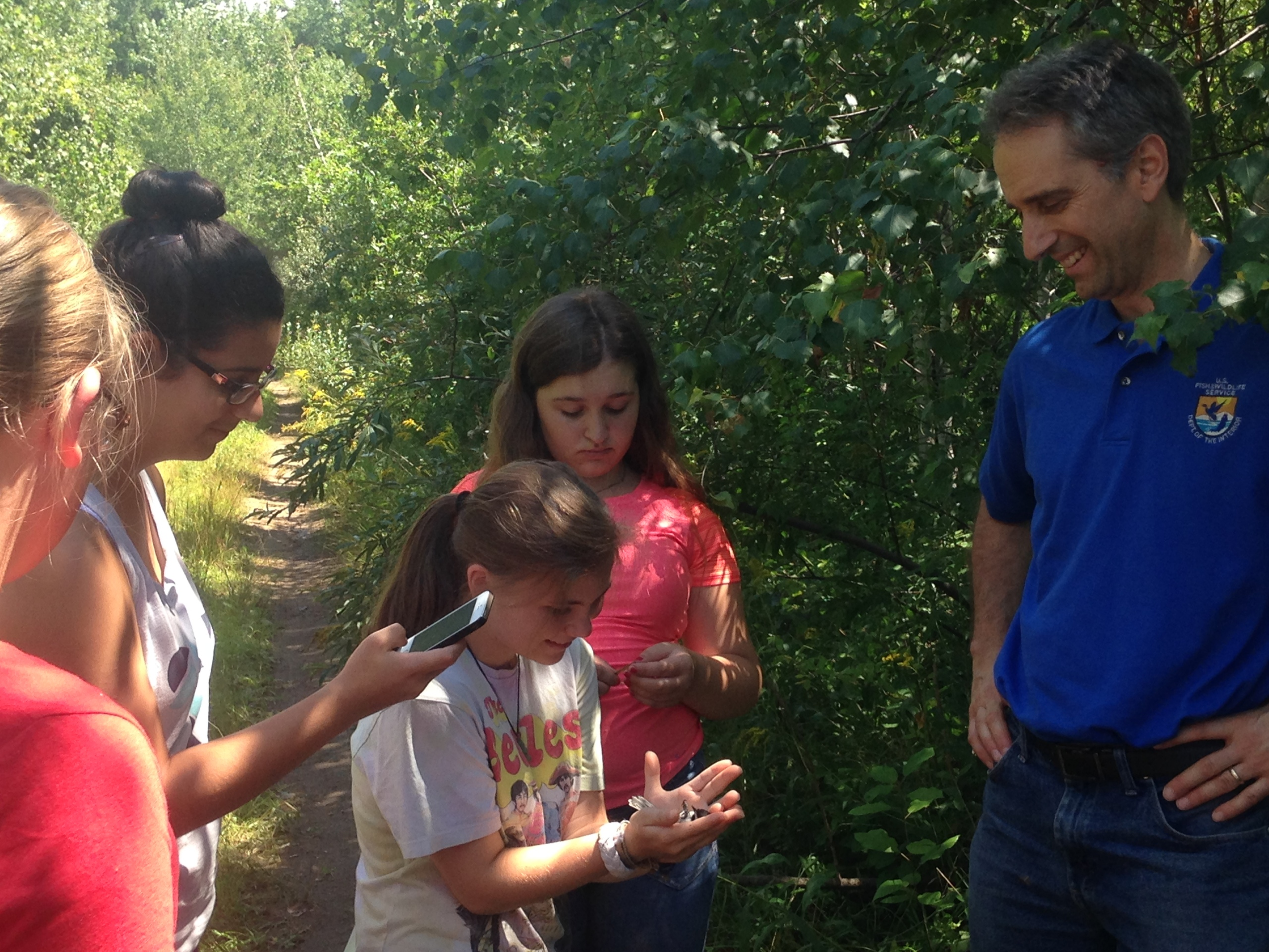 Dr. Randy Dettmers, wildlife biologist at U.S. Fish and Wildlife Service, teaches high school girls about bird conservation techniquest at Silvio O. Conte National Wildlife Refuge.