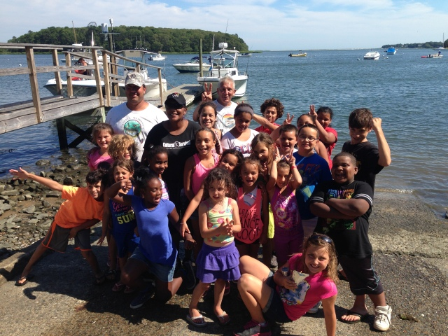 A group of Summer Turtle campers gathers for a photo after a successful fishing trip. Photo Credit: DJ Monette, USFWS