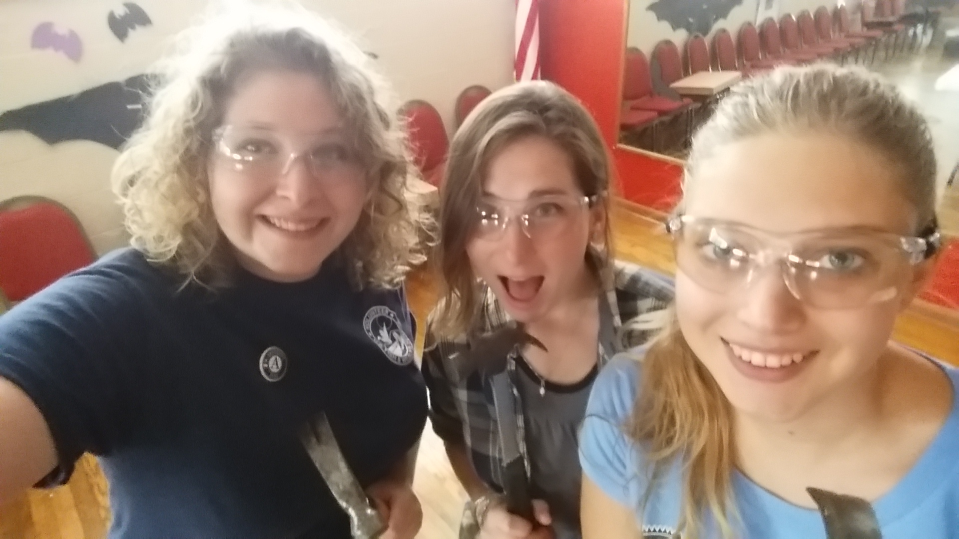 Peters (left) getting ready for day two of Bat Week - building bat boxes - with fellow AmeriCorps members, Lauren Merrill (middle) and Maddy Ball (right). Credit: Emily Peters/AmeriCorps
