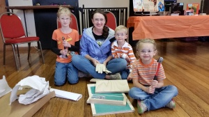 """A family prepares to get """"batty"""" and build a bat box together for Bat Week in Elkins, W.Va. Credit: Emily Peters/AmeriCorps"""