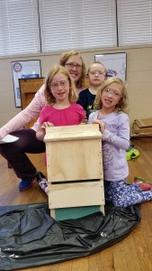 A family proudly displays the bat box they built together during the second day of Bat Week in Elkins, W.Va. Credit: Emily peters