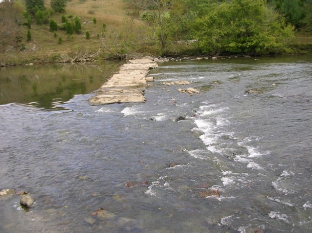Here is the low-water bridge. Might not look like much, but the bridge has made this place a challenge for fish and a flood danger. Credit: USFWS