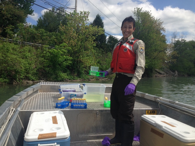 One of the AIS crew members takes environmental DNA samples out in the field. Environmental DNA uses genetics to look for invasive species in water samples. Photo credit: USFWS