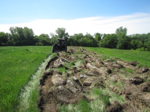 Preparing the landfill for pollinator seed planting. Photo Credit: USFWS