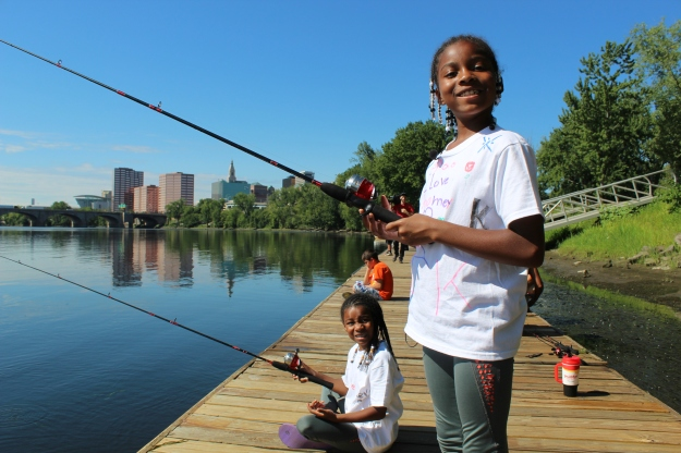 Fishing off the docks at Riverside Park in Hartford, Connecticut. The park, which is open to the public, provided a great location for the city's first Cops and Bobbers, Hooks and Ladders youth fishing event.