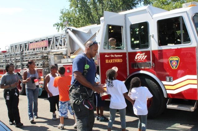 Kids got a close-up and personal look at the city's fire and safety equipment while also talking with firefighters and EMTs. Photo credit: USFWS