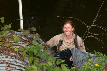 Devers smiles in front of one of the 3 percent of culverts that biologists like her have assessed in Maryland. Credit: Steve Droter