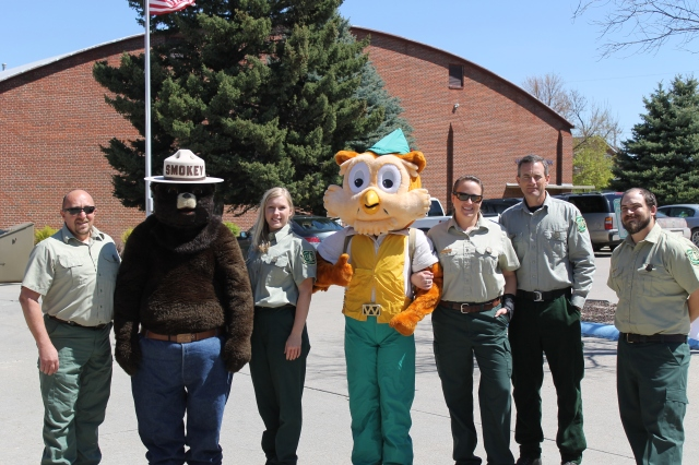 The U.S. Forest Service team at an outreach event; hint: Amanda is dressed in the Woodsy Owl costume. Photo courtesy of Amanda.