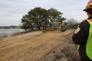 The Pisten Bully pushes sediment from a high elevation to spread it across low areas.