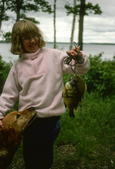 Daughter Emily with some big sunfish caught while camping in Minnesota in 1993