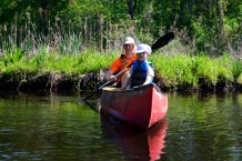Nick Nelson and his son enjoy the sunshine on the Shawsheen River. Credit: Floyd Greenwood
