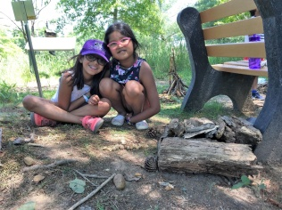 Kids had the opportunity to build fairy houses during our Play in the Park event. Photo credit: JoAnna Marlow