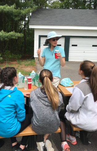 Amoskeag Fishway educator teaching 7th graders about watersheds and water quality.