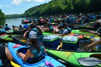 """Jamilla Martell, also expressed that the Potomac River kayaking and canoeing trip was one of her favorites too. Of that day, her favorite moment was wading in the water, linking arms in a circle, and floating down the river. """"It felt really united,"""" Martell said. Ben Hunter-Francis II also admired Mike, our kayak and canoe Trip leader, who reminded Hunter-Francis II to take a few minutes to listen to nature. It was at that moment, that all 103 indigenous youth and another 100 or so chaperones, faculty, and junior faculty locked water boats and took a moment in silence to listen to our surroundings. Maybe, we all learned something too."""