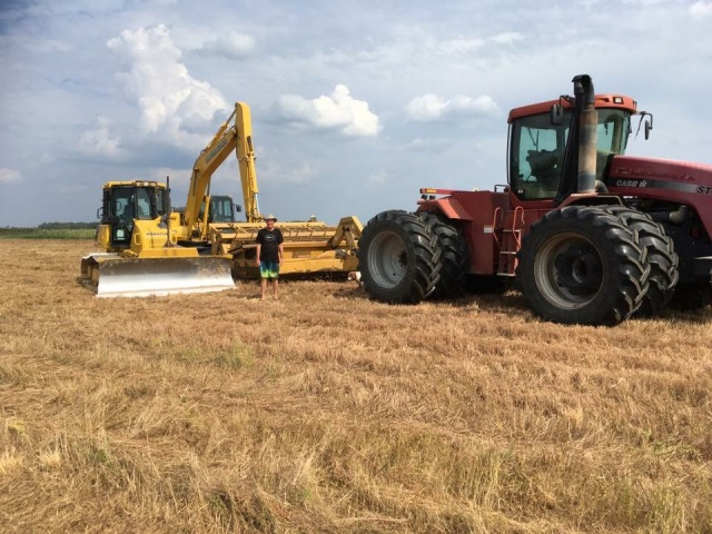 Work at the Spiering farm. Photo courtesy of Bob.
