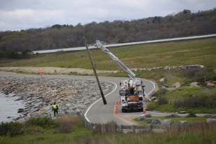 The last utility pole along the access road comes down. Credit: USFWS