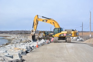 Following Hurricane Sandy, the Service and its partners strengthened the access road by adding armor stone along the ocean side. Credit: USFWS