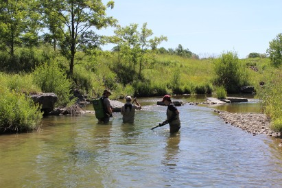 Bret Serbin (far right) assisting fish biologists with Electro-fishing