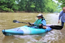 Sally Egan, Member Guardians of the West Fork gets launched with a little help. Credit_ Haley Hutchins, AmeriCorps