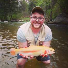 Craig Gaviglia holds a Palomino Trout he caught in a tributary to Allegheny River.