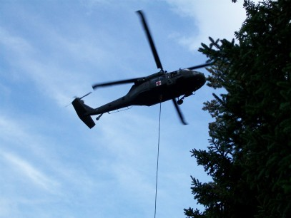 Maine Air Gaurd Black Hawk helicopters transporting crucial supplies to the pond. Credit: Maine DIFW